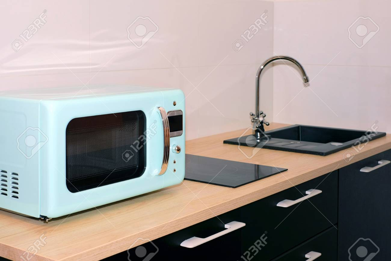 Kitchen sink and water tap in the kitchen in a modern apartment...