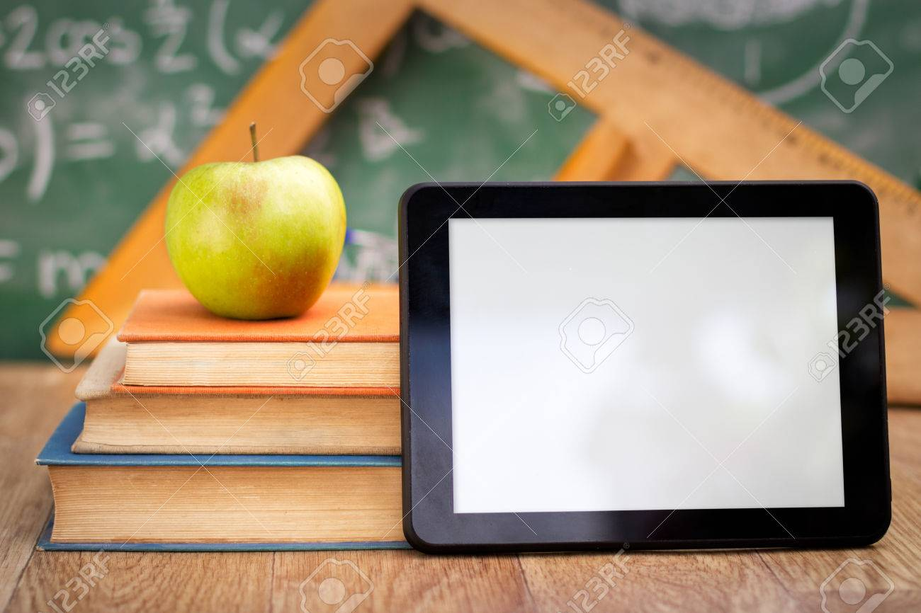 Empty tablet pc with books, technology and education Standard-Bild - 33271957