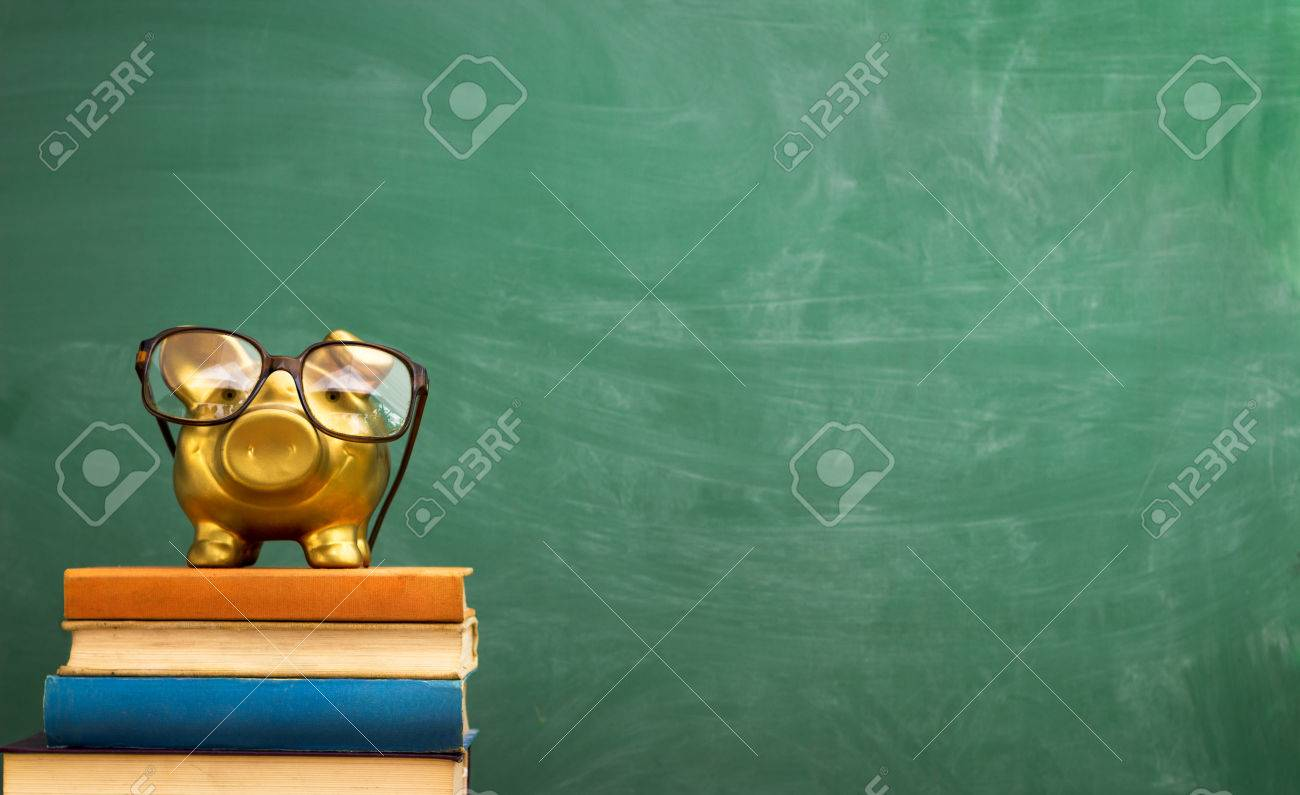 piggy bank with glasses on books, education concept - 33271961