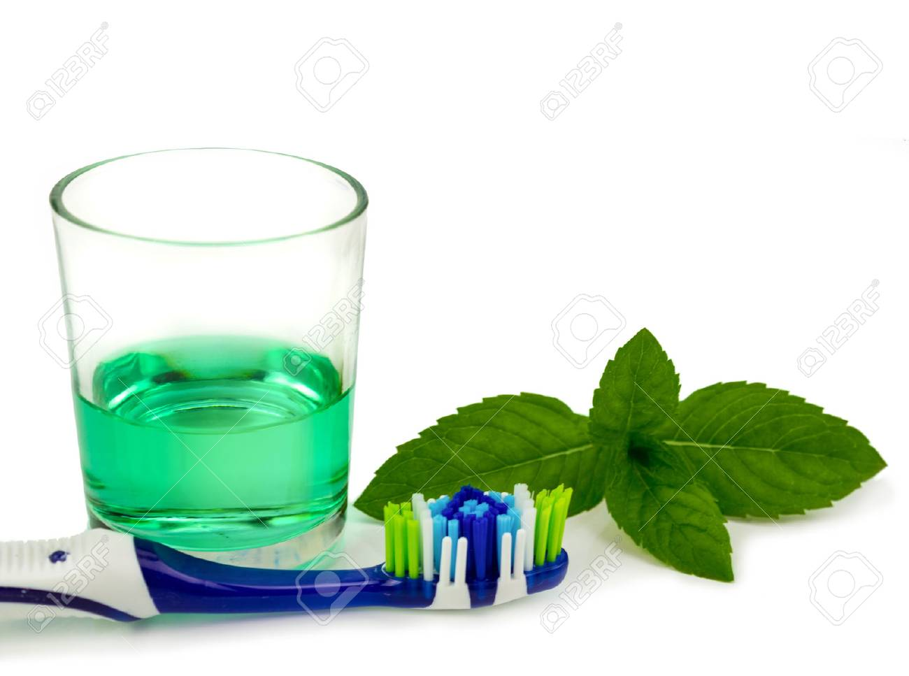 Toothbrush and mouthwash isolated over white - 71338384
