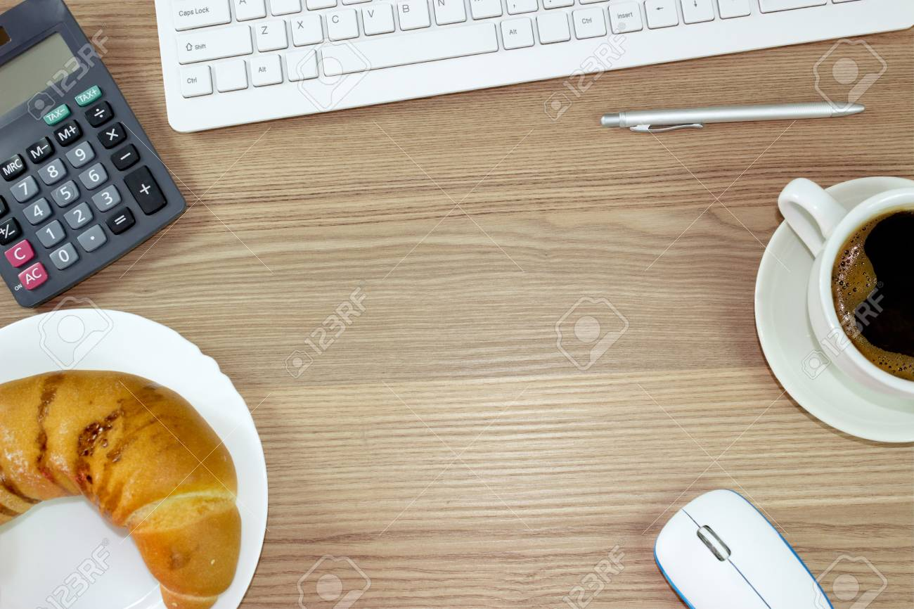 top office table cup. Stock Photo - Top Office Table With Cup Of Coffee, Snack, Pencil, Mouse And Keyboard