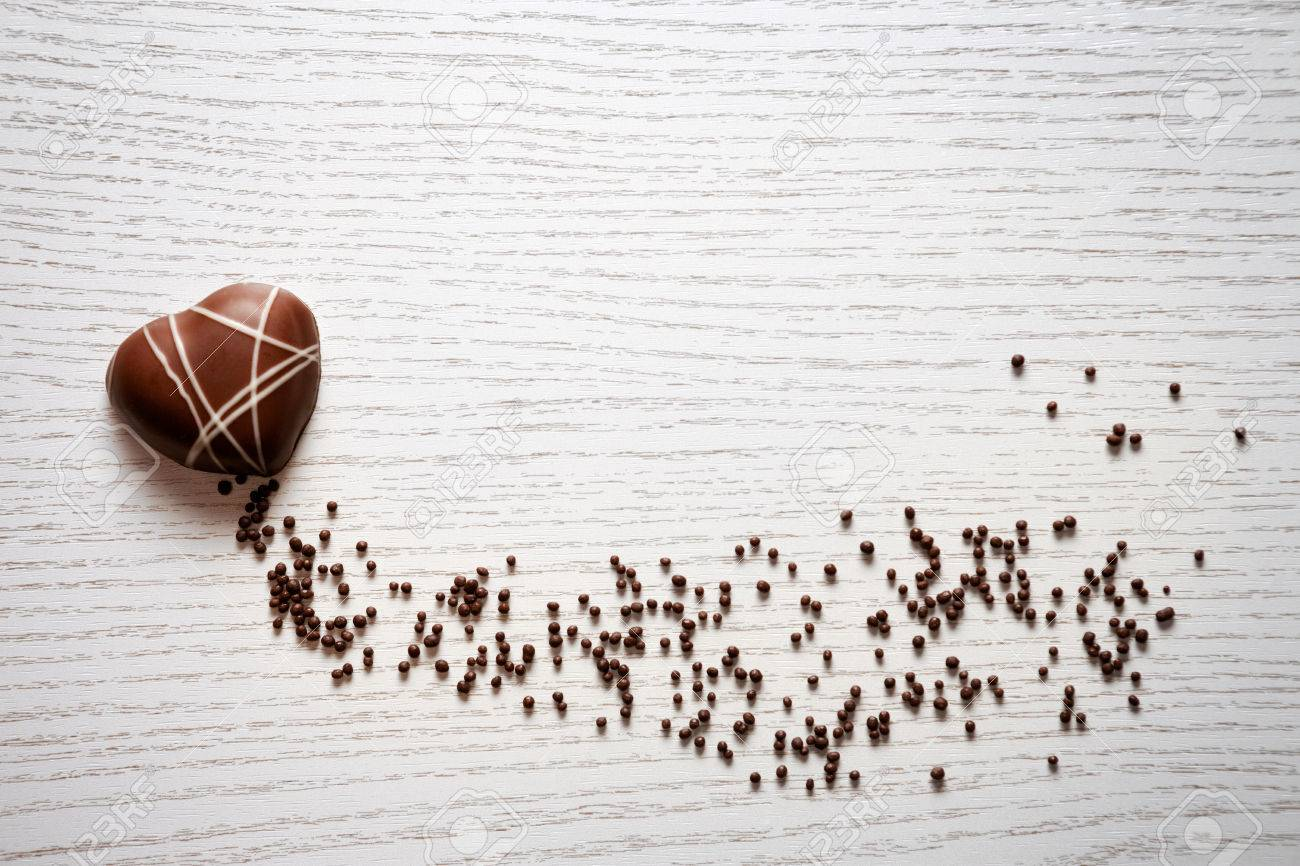 Heart shaped chocolate on white background Standard-Bild - 73214913