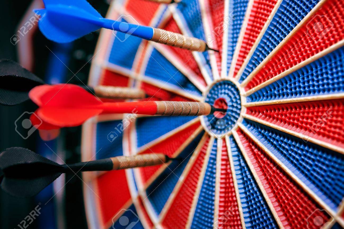 darts in bullseye in dartboard close up of darts on the board stock