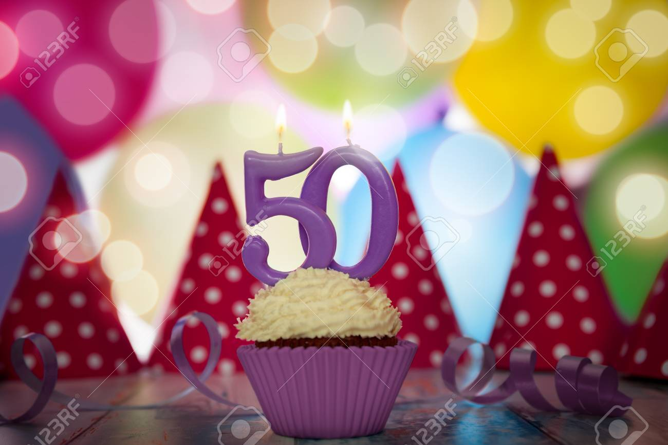 Birthday Party For Fiftieth With Cupcake And Candle Stock Photo