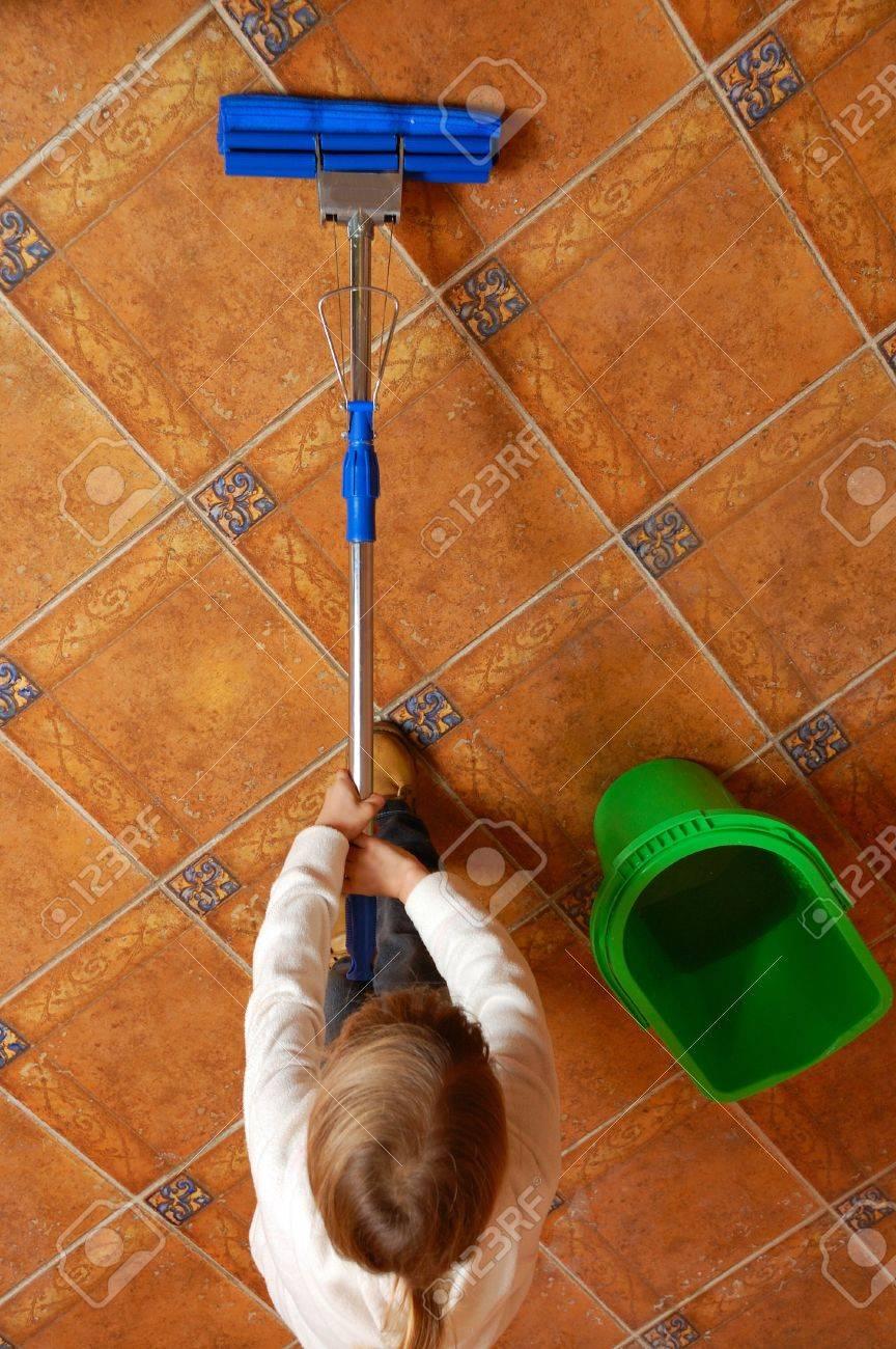 little girl washing the floor with swap Stock Photo - 5968944