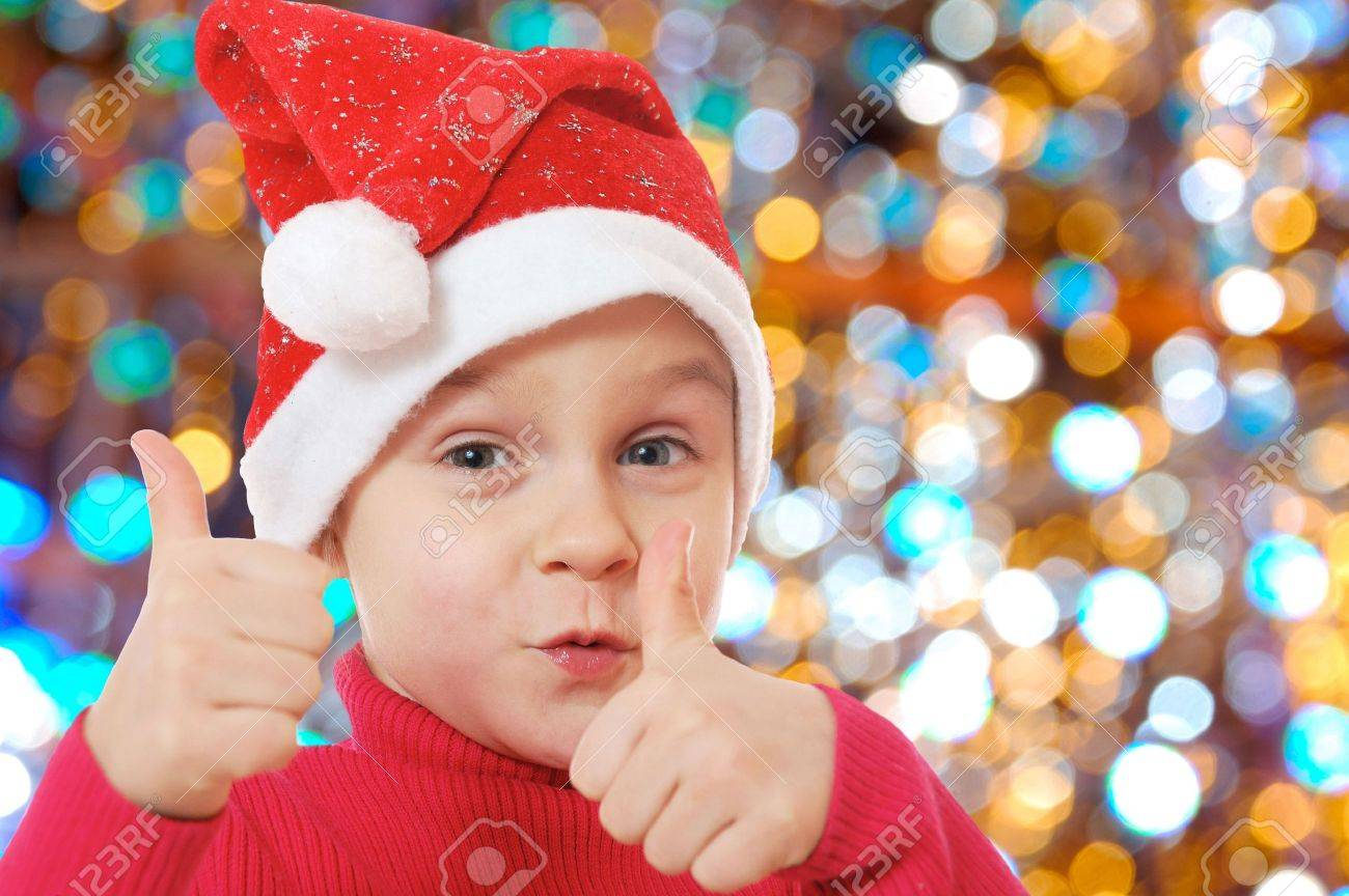 little happy girl wearing a Santa Clause hat Stock Photo - 6190684