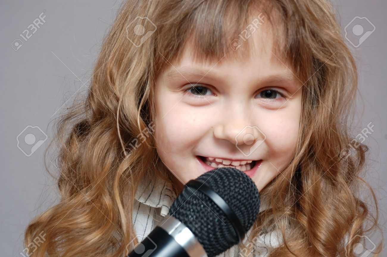 cute little girl singing with a microphone Stock Photo - 6743607