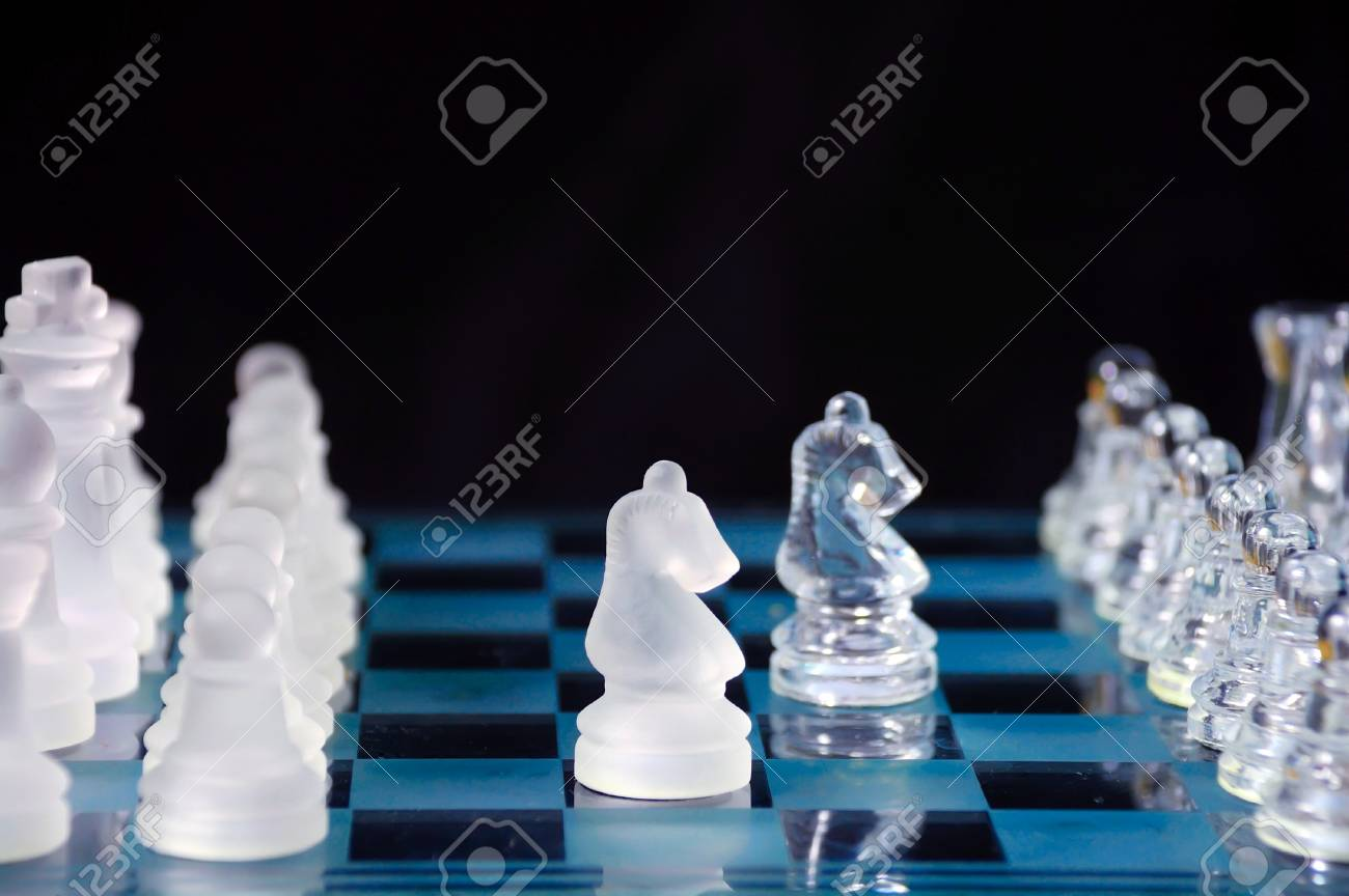Set of chess withstands on the glass checkerboard. Stock Photo - 7061749