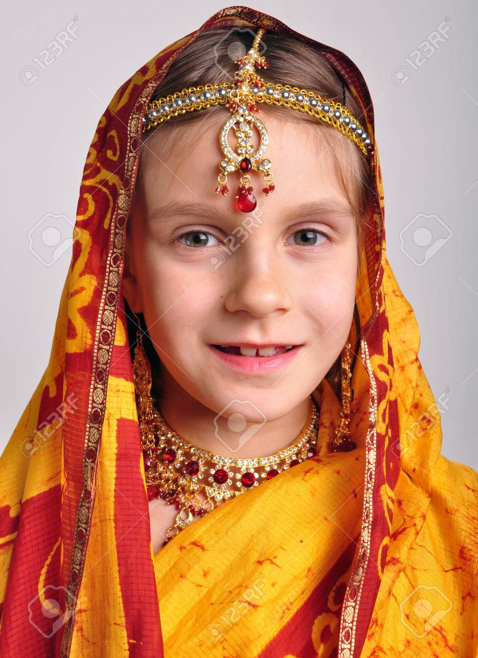 ef6986276c close-up studio portrait of little girl in traditional Indian clothing sari  and jeweleries Stock