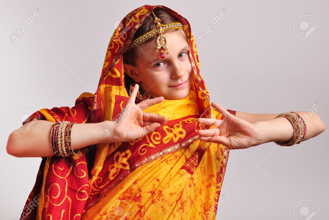 c8fbe7b04f Stock Photo - studio portrait of little girl in traditional Indian clothing  and jeweleries