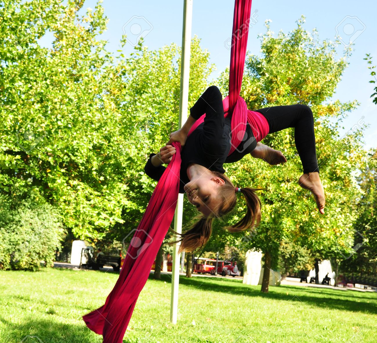 Outdoor Activity Of Cheerful Child Training On Aerial Silks Or ...
