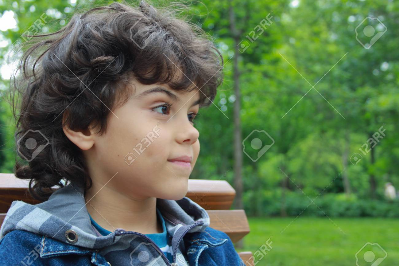 Beautiful boy in the park Stock Photo - 13791756