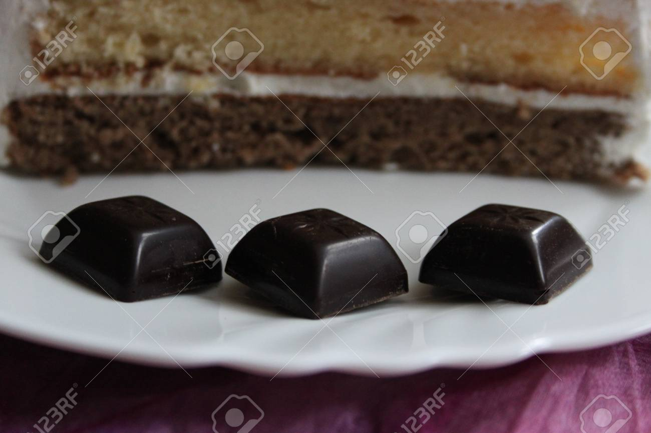 Chocolate candies and three - layer cake as background Stock Photo - 16714653