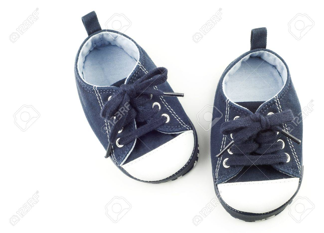 7052dc68b372 A Tiny Pair Of Blue Infant Shoes For A Boy