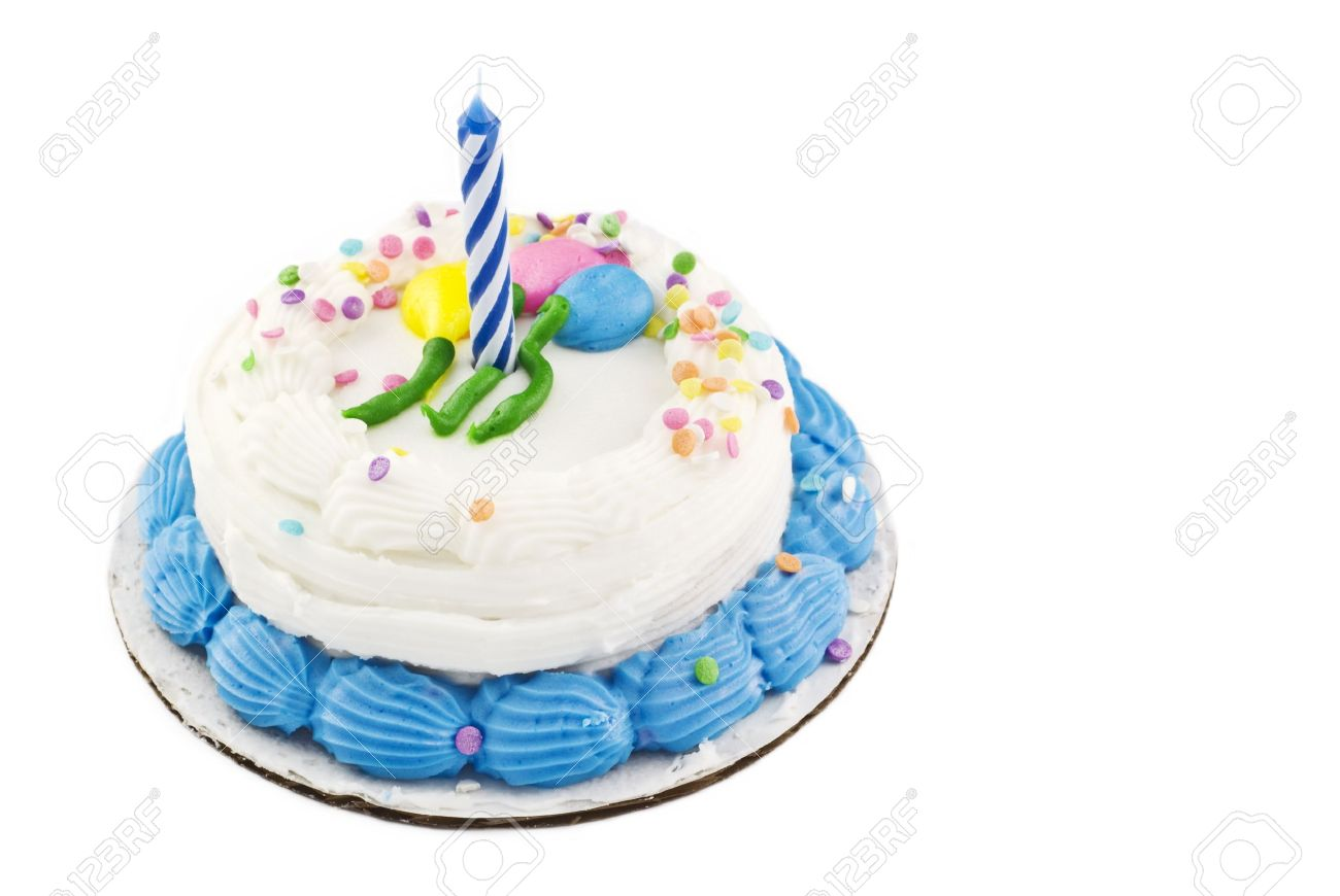 A Small White Birthday Cake With Balloon Decoration And Candy Sprinkles One Unlit Candle Stock