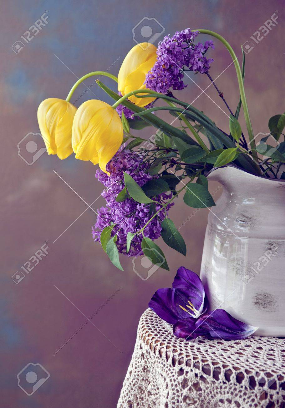 A Beautiful Spring Flower Arrangement With Yellow Tulips And Stock