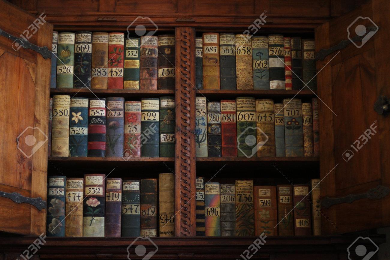 Old Books On A Medieval Bookshelf In Prague Castle Stock Photo