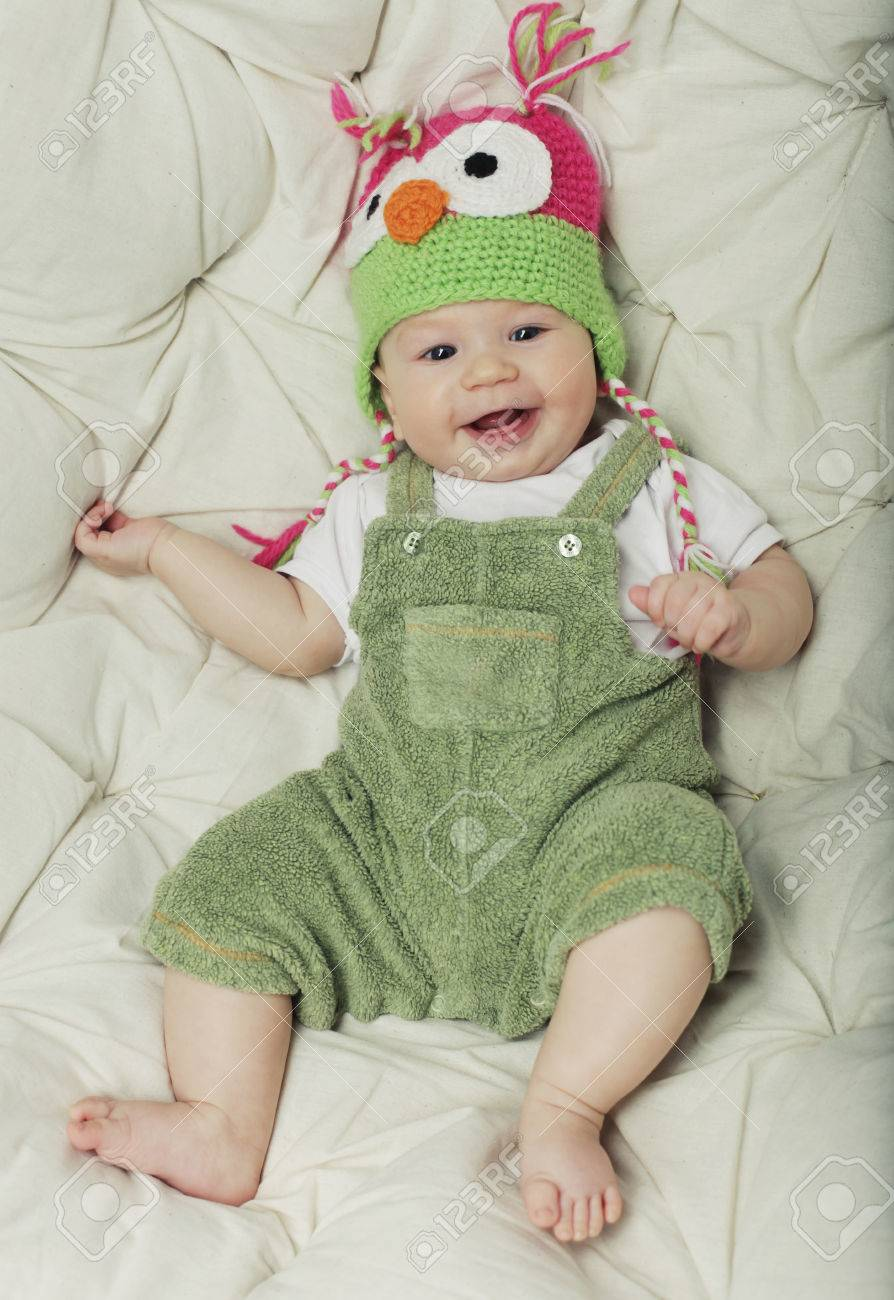 093adaf33 Portrait Of Cute Happy 5 Month Old Baby Boy With Funny Hat. Photo ...