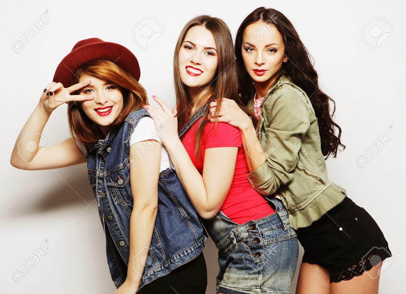 Three Stylish Sexy Hipster Girls Best Friendsstanding Together