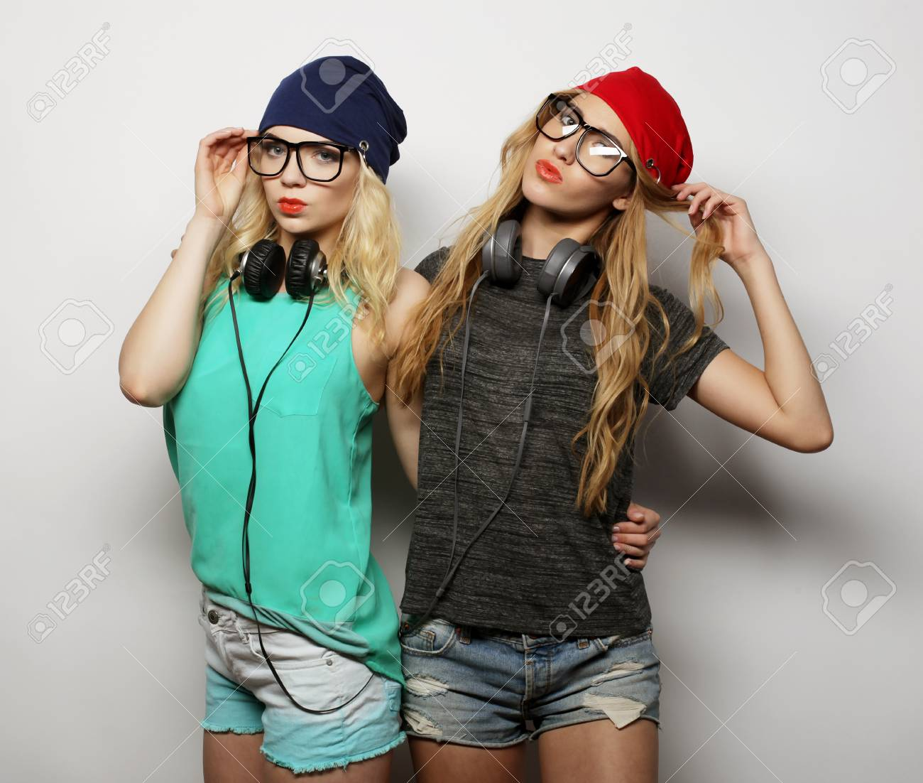 fe37d0272b2 Stock Photo - Studio lifestyle portrait of two best friends hipster girls  wearing stylish bright outfits