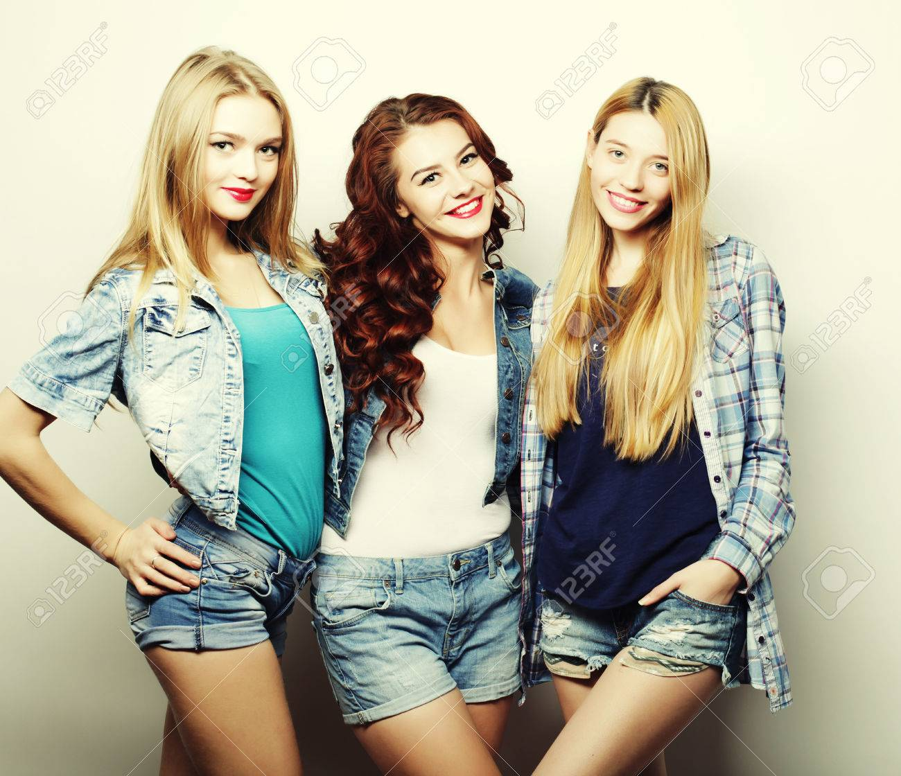 three best friends posing in studio wearing summer style outfit