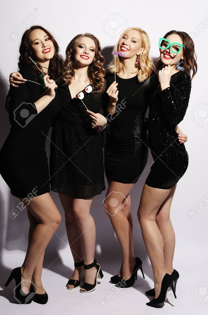 57d7f81e7595a0 Stock Photo - Stylish sexy girls best friends ready for party. Black dress
