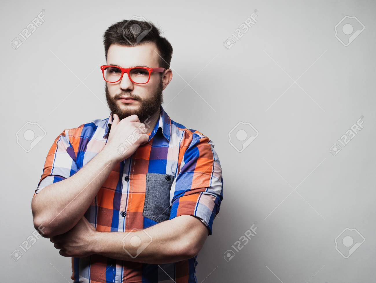 21c8ee062f3 Serious bearded man wearing eyeglasses and plaid shirt. Stock Photo -  101208533