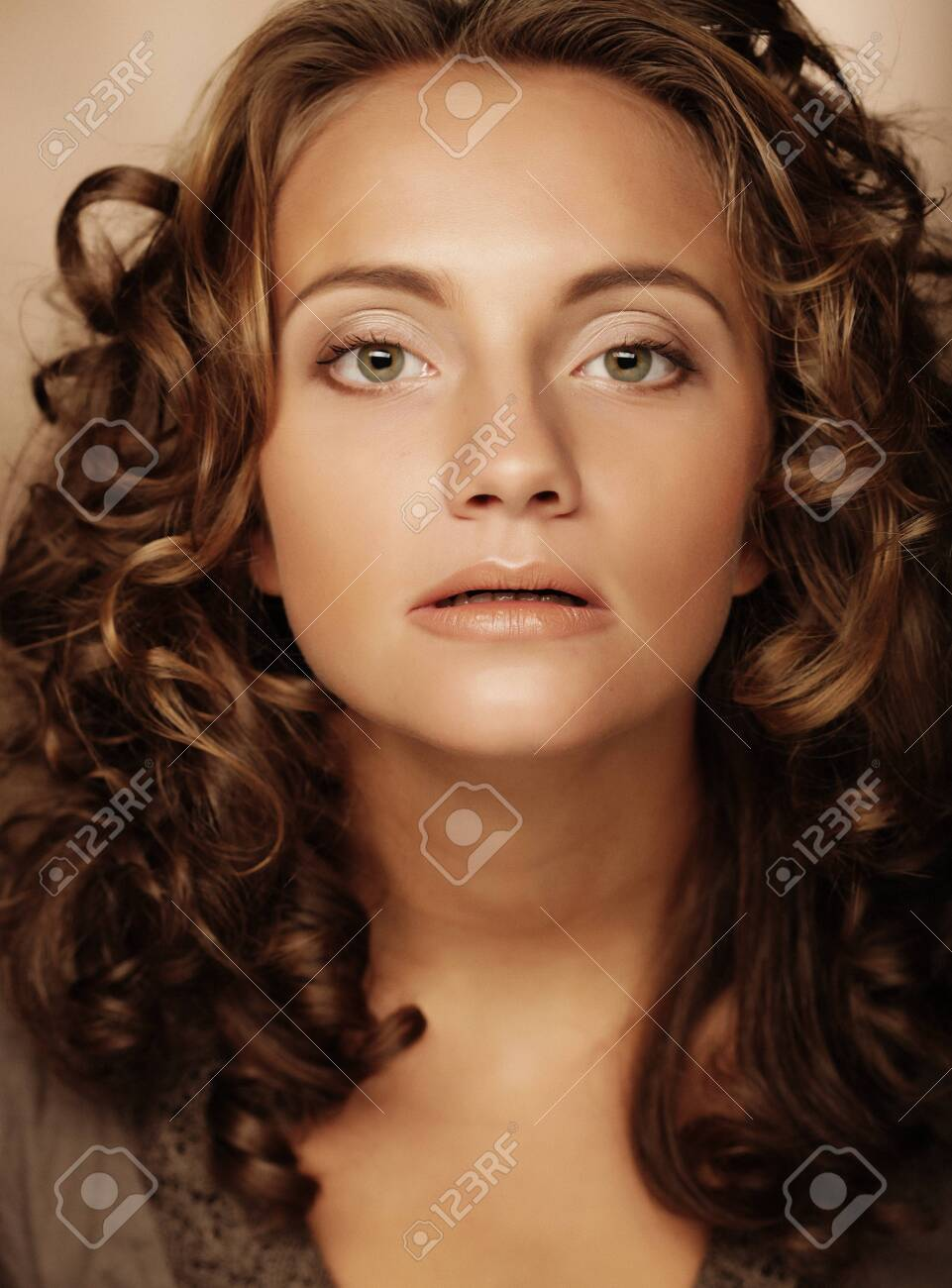 young woman with cury hair - 120868346