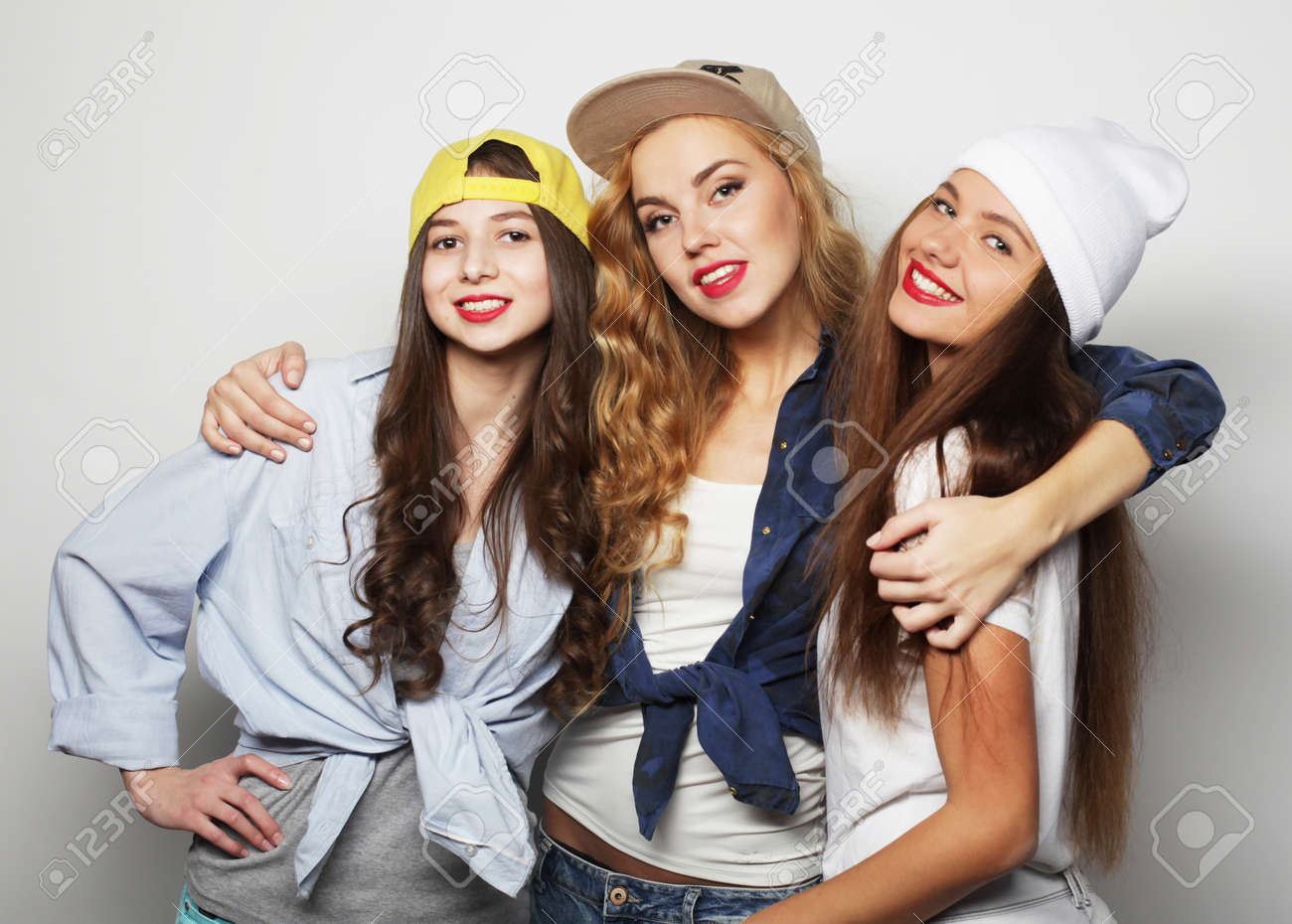 Three young girl friends standing together and having fun. - 170365007