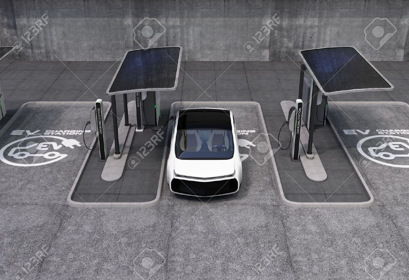 Electric vehicle charging station in public space. The charging spot support by solar panels, storage batteries. - 53666202