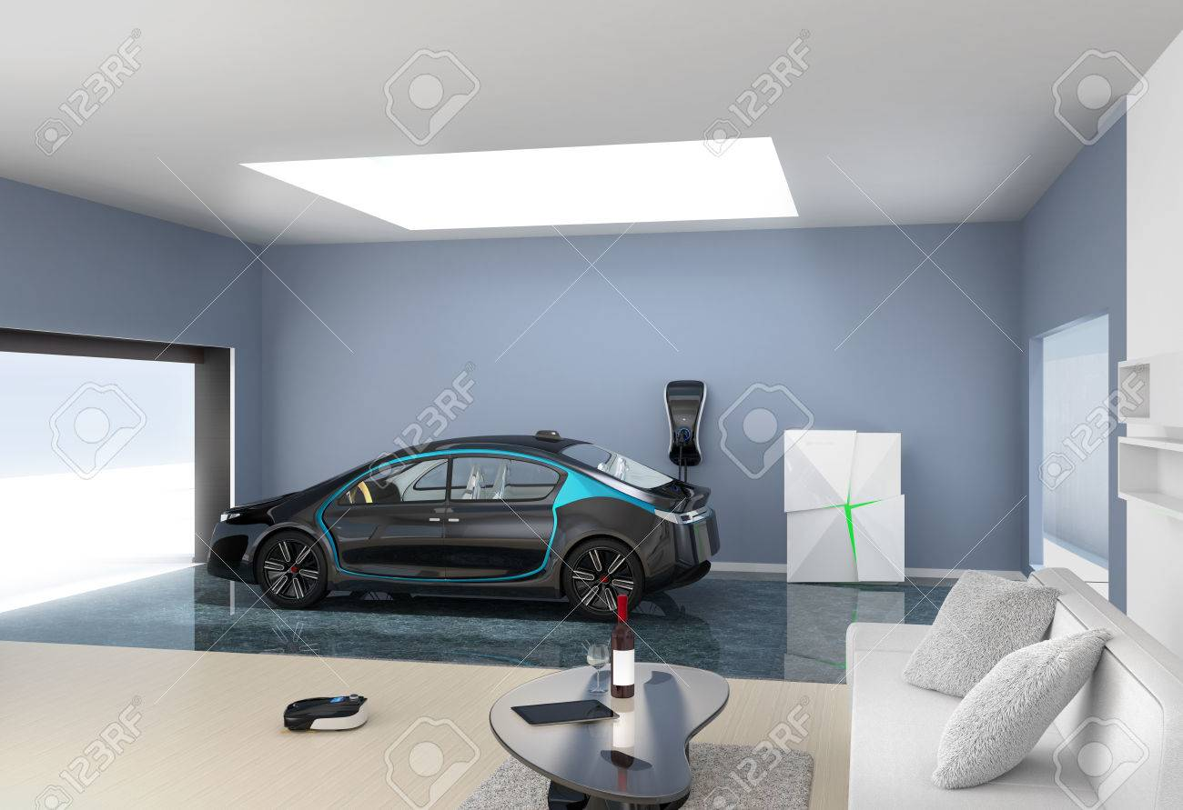 Black Electric Car Park Into Modern Garage. The Garage Connect With Living  Room Which Show