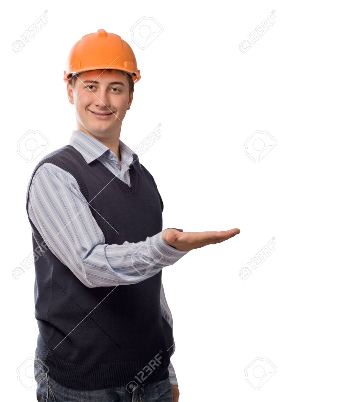 man in orange helmet showing empty palm, isolated on white background, copy space Stock Photo - 3444702