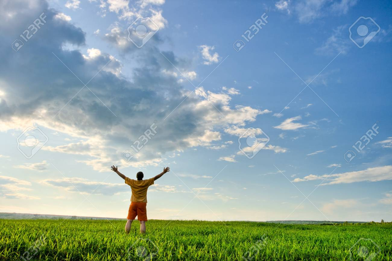 man in the field, rising hands Stock Photo - 5242092