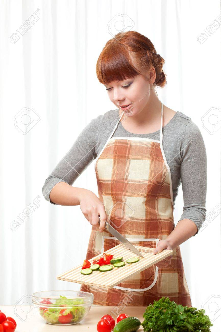 White apron ladies - Stock Photo Ginger Woman Wearing Apron Cooking Salad Over White