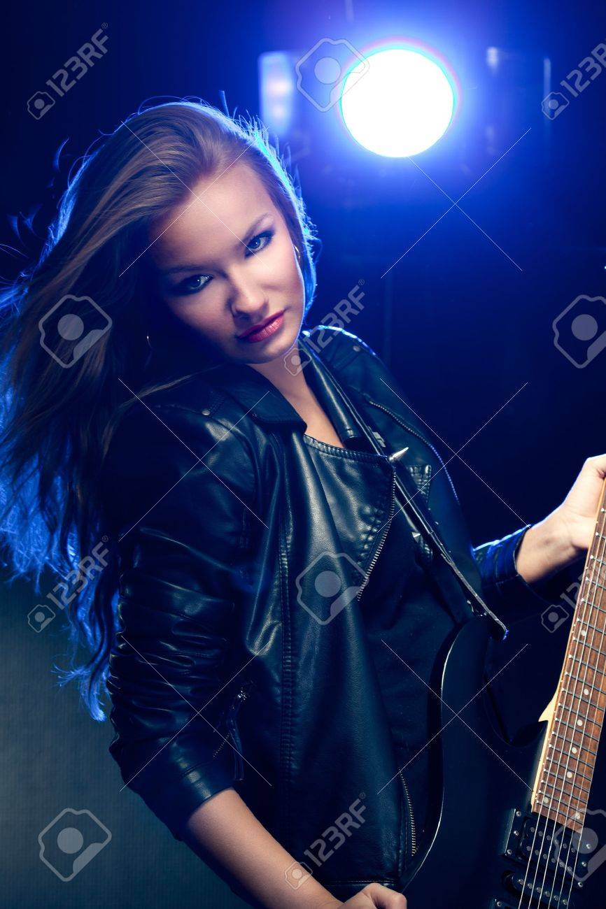 blonde woman rock star portrait with guitar Stock Photo - 8987194