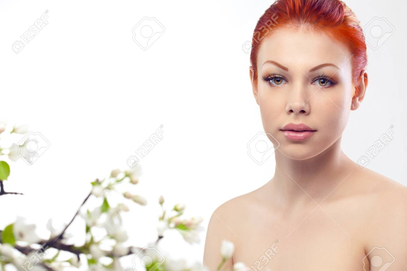 beautiful woman portrait with flowers over white Stock Photo - 10191699
