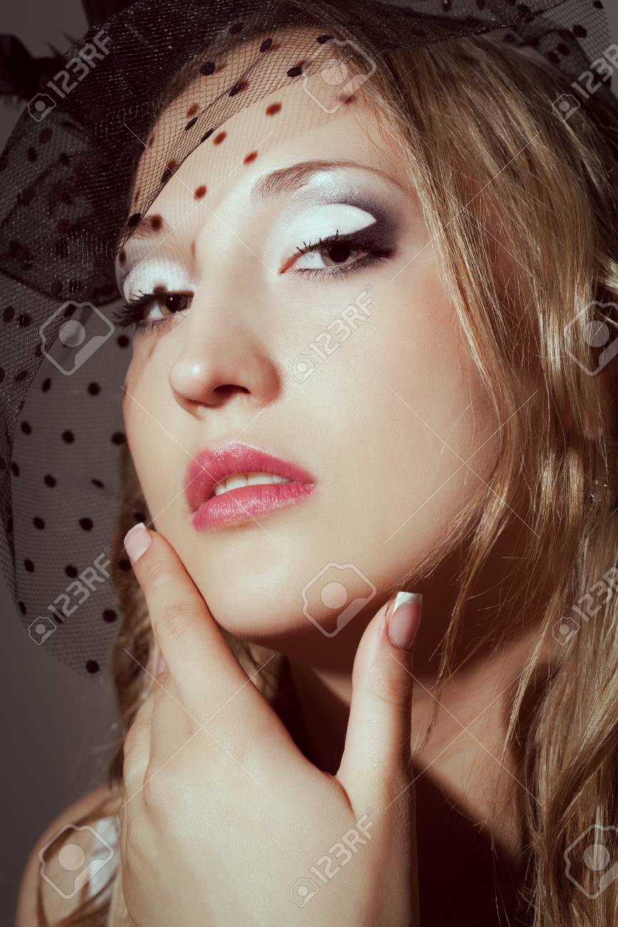 closeup woman face retro styled studio portrait Stock Photo - 10258885