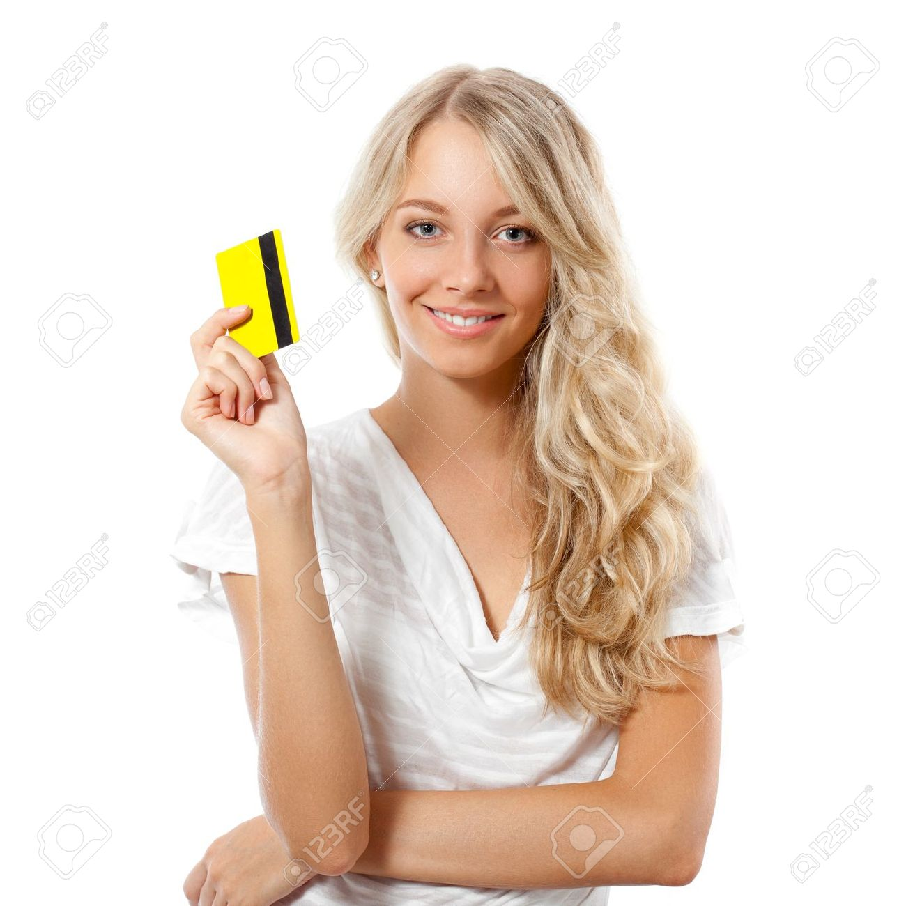 blonde happy woman holding yellow credit card stock photo picture
