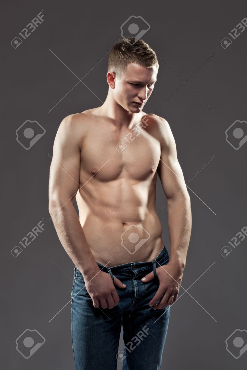 Sexy Guy Shirtless Man With A Muscular Body Posing In Jeans With ...