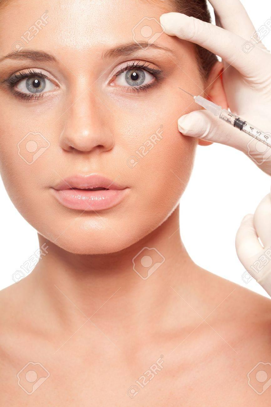 closeup beautiful woman face, syringe injection beauty concept Stock Photo - 18387389