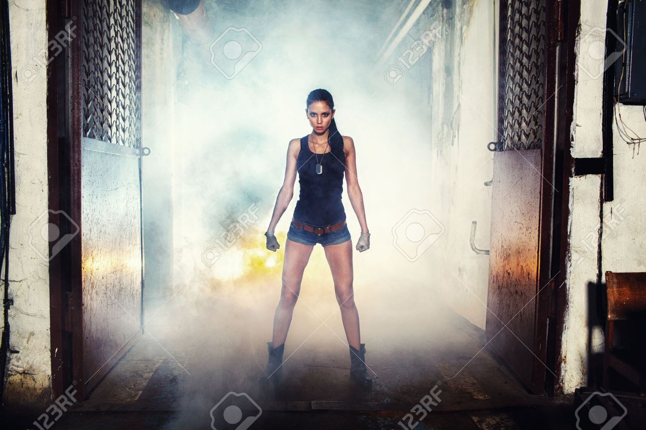soldier woman on factory ruins, action movie theme - 31053534