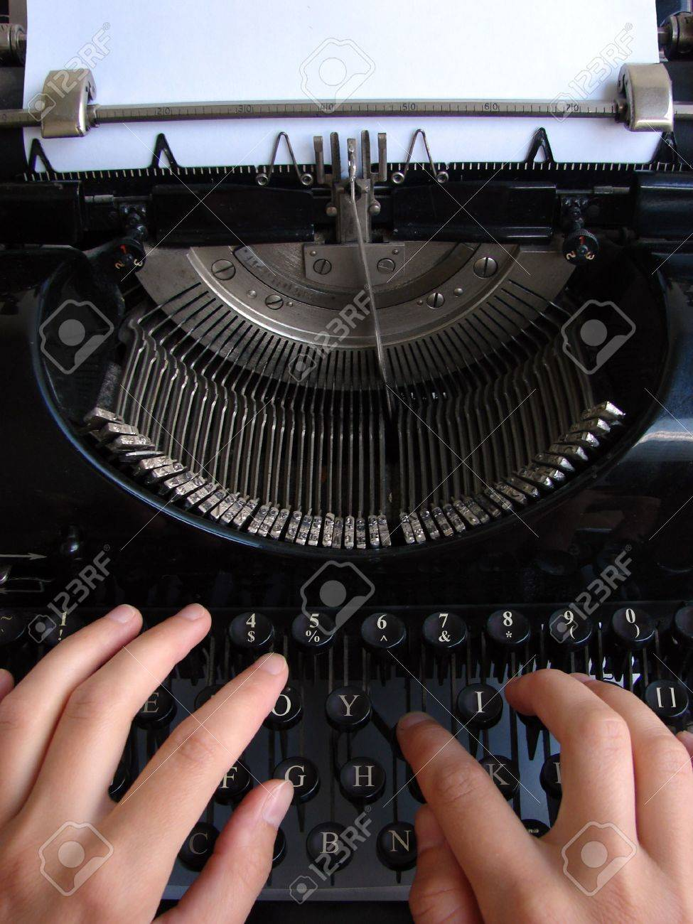 Hands typing on old typewriter Stock Photo - 5415501