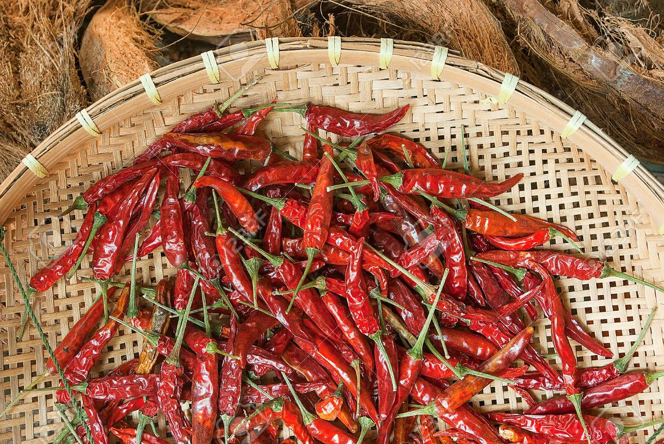 Red Hot Chili Peppers Drying In A Bamboo Basket In Thai Kitchen ...