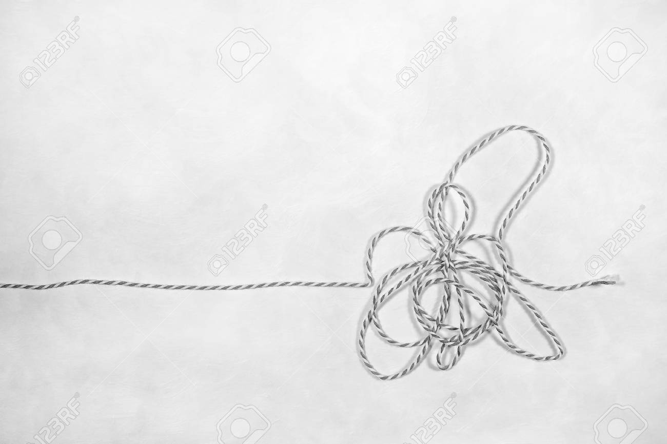 A Tangled Piece Of String Layed Out On A White Background Black Stock Photo Picture And Royalty Free Image Image 94069432