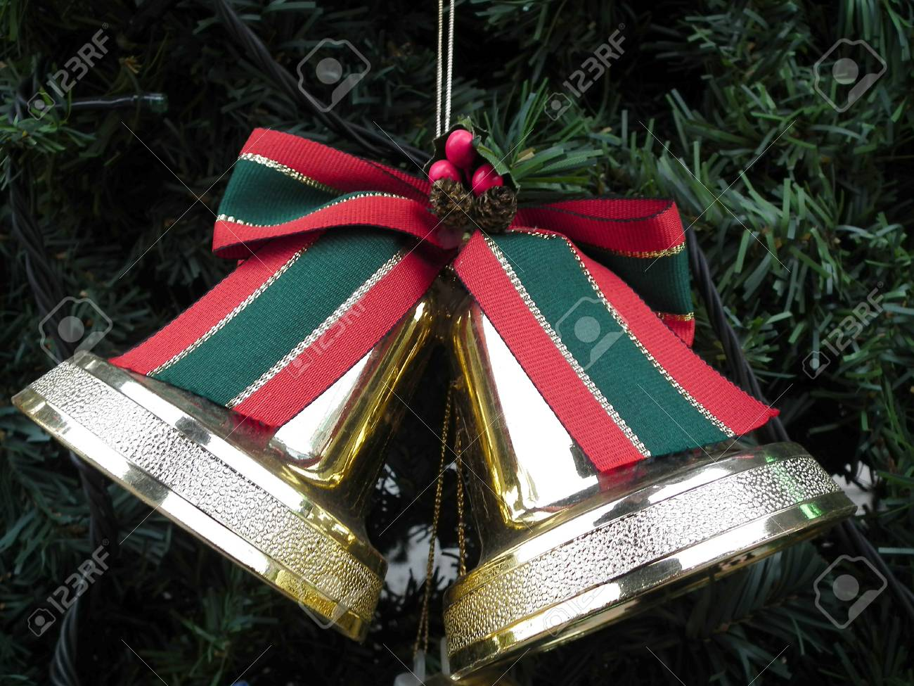 stock photo the christmas accessories of gold jingle with colored ribbon