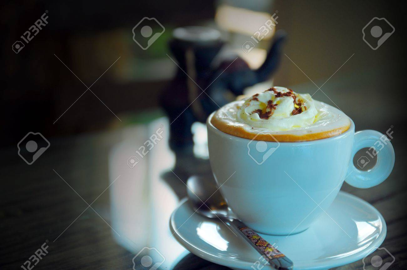 Coffee with Whipped cream in a white cup Stock Photo - 16228158