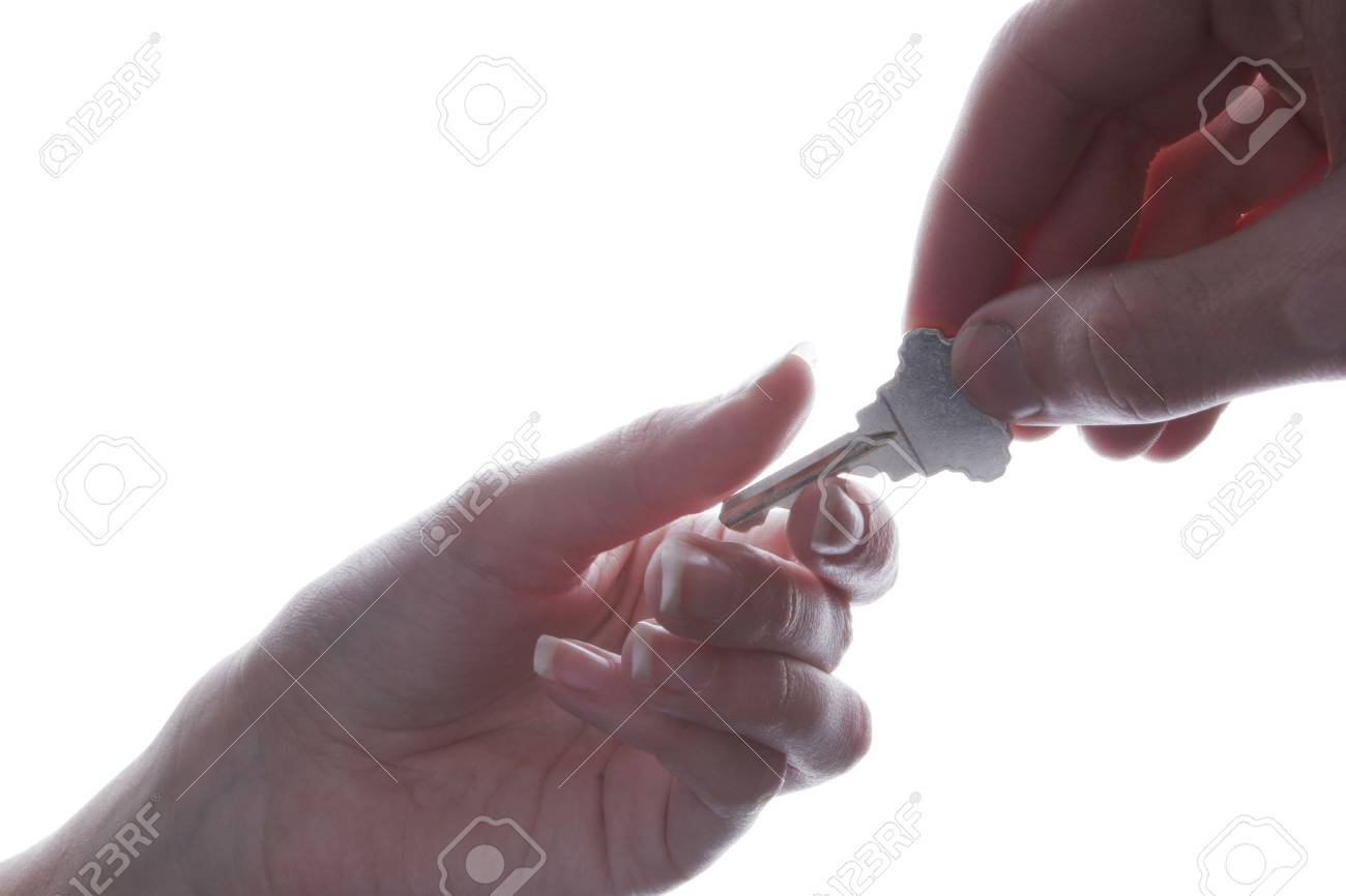 Handing over the key isolated on white background Stock Photo - 926475