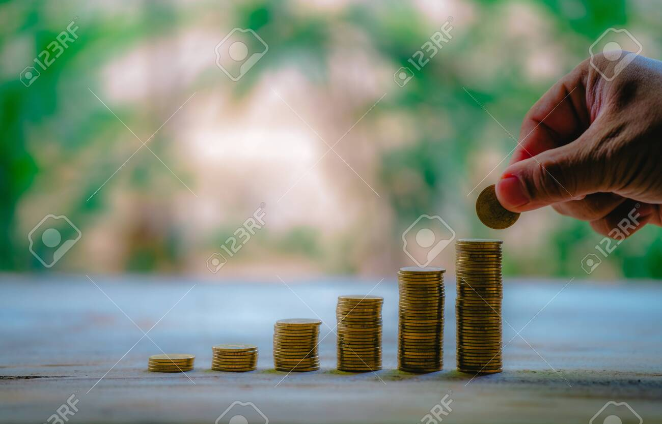 Place coins to collect coins, savings and income, or investment ideas and financial management for the future. - 122398354