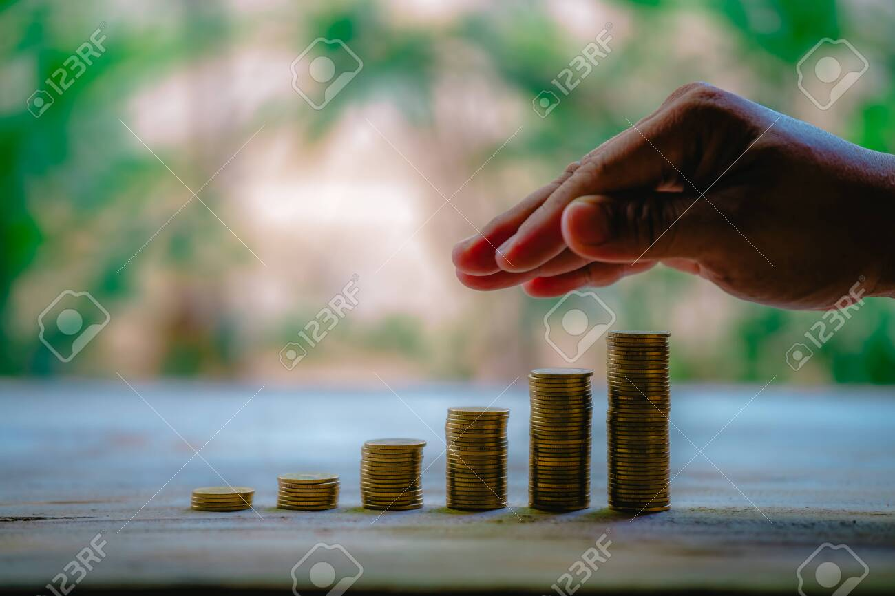 Place coins to collect coins, savings and income, or investment ideas and financial management for the future. - 122398353