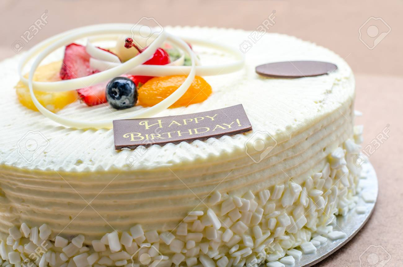 Vanilla Cake And Fruit With Words Happy Birthday On It Stock Photo